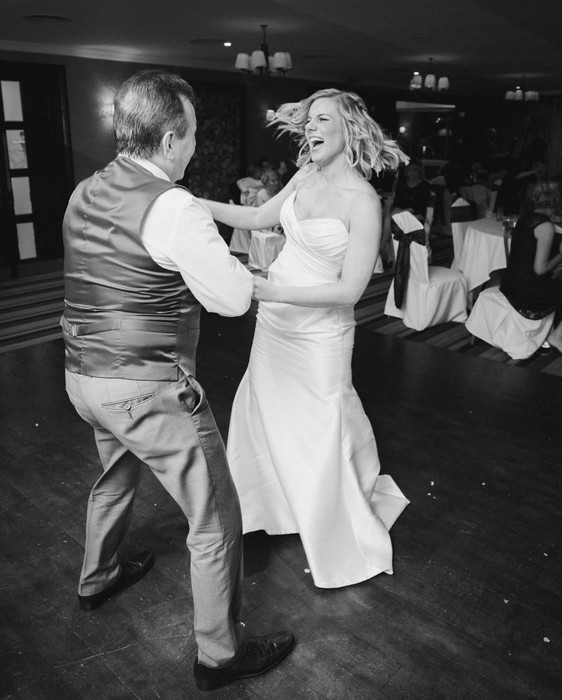 Bride and father of the bride dancing at the wedding reception. Midlands documentary wedding photographer.