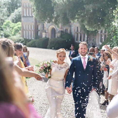 Documentary wedding photography Midlands. Bride and groom confetti photo at wedding reception.