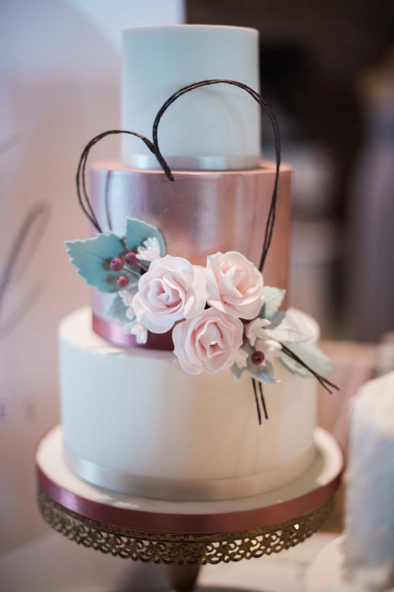 Emily Twyford Wedding Cakes. Classic wedding cake inspiration. Elegant roses on tiered wedding cake. Darley and Underwood - Documentary wedding photographer Leicester.