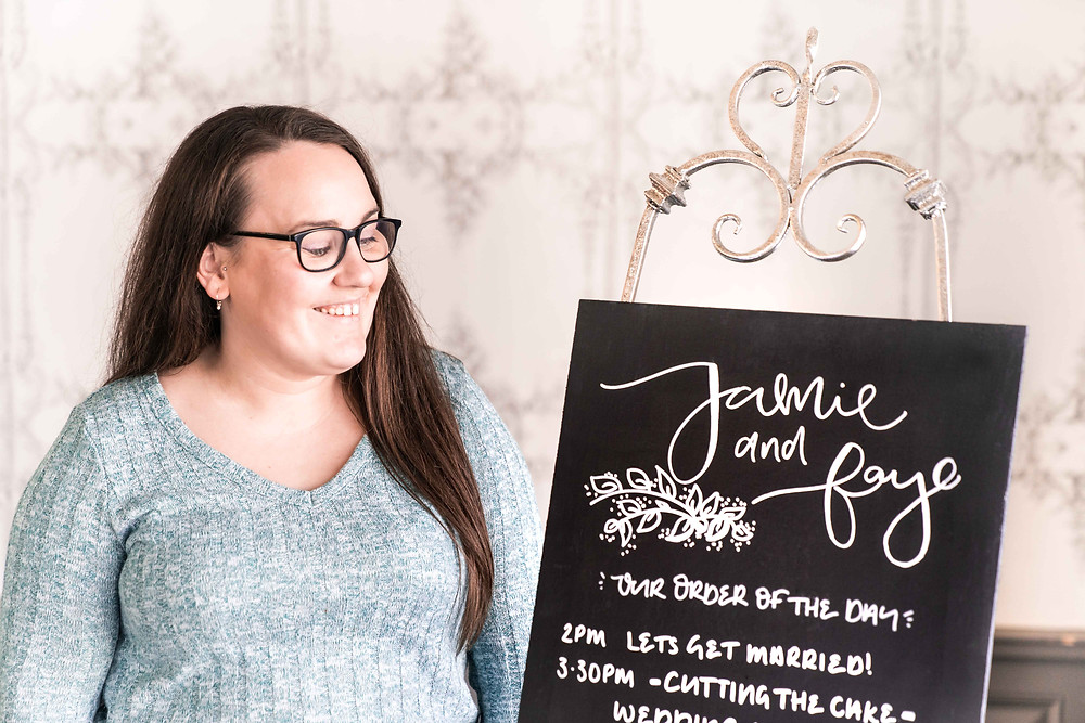 Faye - owner of Wild Calligraphy with her chalkboard order of the day. Natural Nottinghamshire wedding photography.