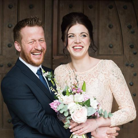 Natural wedding photography at Shustoke Barn, Warwickshire. Boho bride and groom portrait with wedding bouquet.