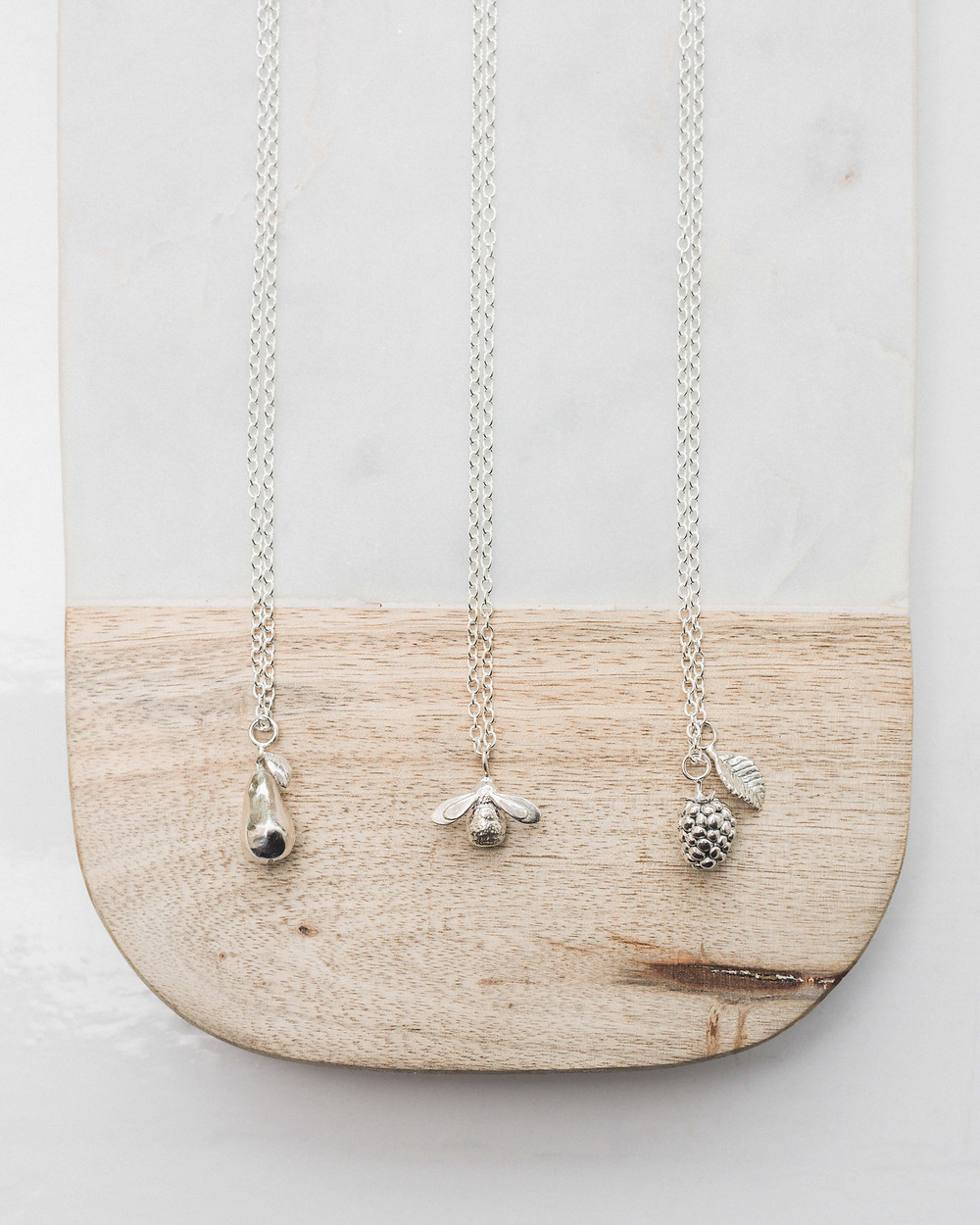 Three of Lucy Flint's favourite pendants. These would make great choices for wedding jewellery. Lucy Flints' silver bracelets could make an ideal choice for your bridesmaids. Image by Darley and Underwood Photography. Wedding photography across the UK.