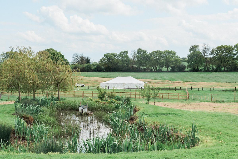 The Hill Farm House landscaped outdoor wedding venue with duck pond and stunning views.
