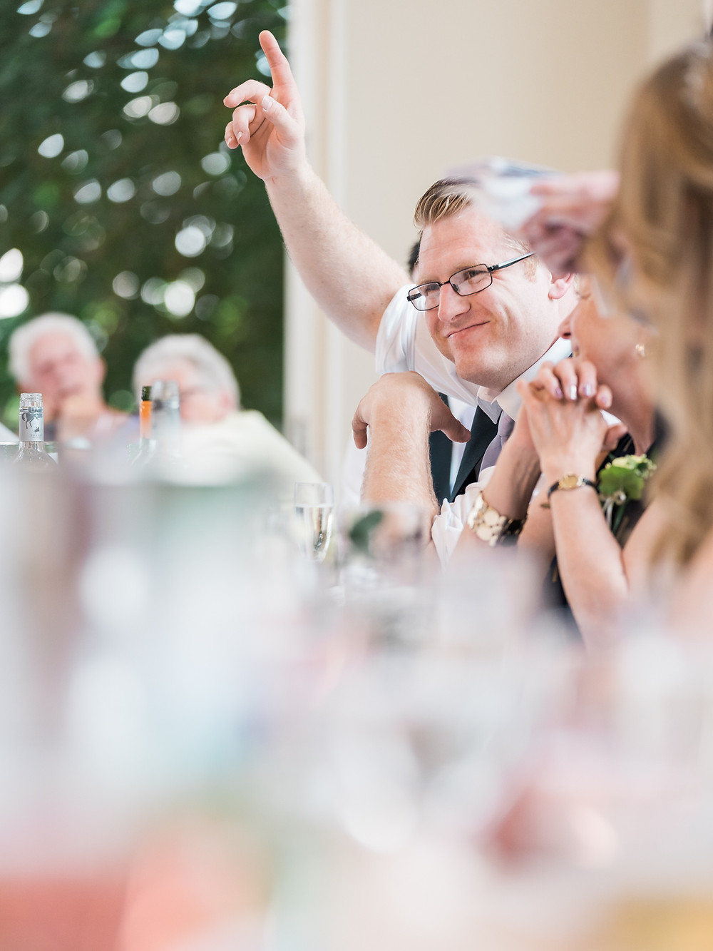 Groomsman at the top table of a wedding at Shottle Hall, Derbyshire. By Derbyshire wedding photographers.