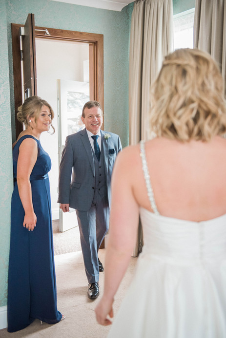 Father of the bride first look - a beautiful moment. Documentary wedding photography.