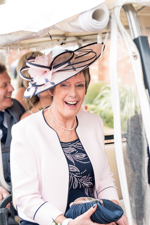 Mother of the bride. Wedding hat. Natural wedding photography at the Nottinghamshire Golf and Country Club.