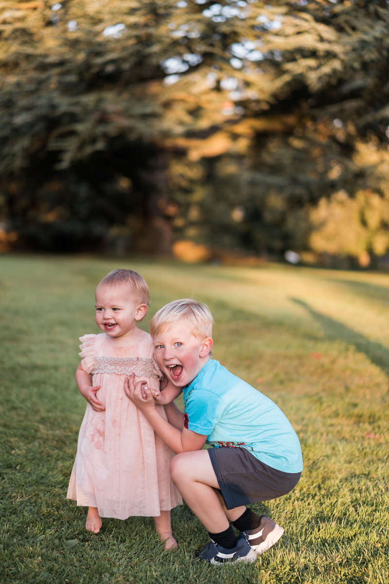 Toddler and young child having fun on the grass at Ashton Lodge wedding venue, Leicestershire. Photography by Darley and Underwood Photography