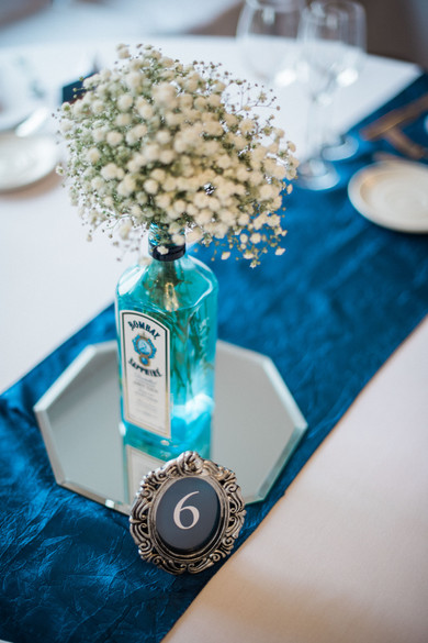 Wedding table decorations - alternative vase. Bombay Sapphire vase. Darley and Underwood Photography.