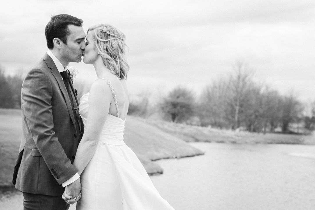 Black and white bride and groom kiss. Countryside wedding venue Nottinghamshire.