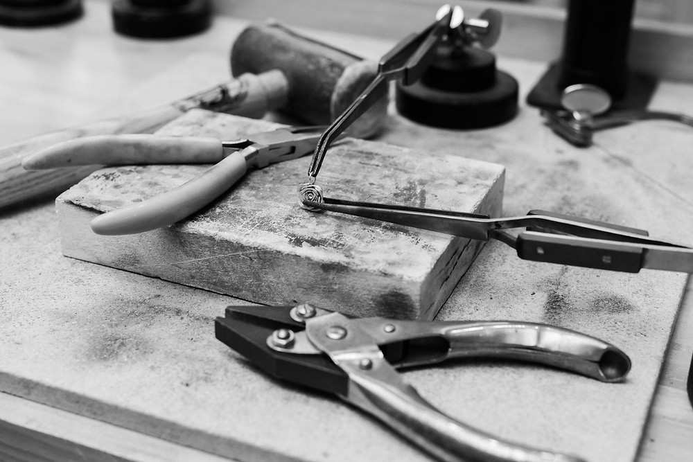 Lucy Flint Jewellery. Pendant on workbench. Image by Darley and Underwood Photography. Film wedding photography.
