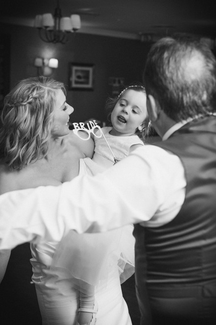 Beautiful wedding photography in the Midlands. Black and white capture of bride and her flower girl. Hitched. Bridebook.