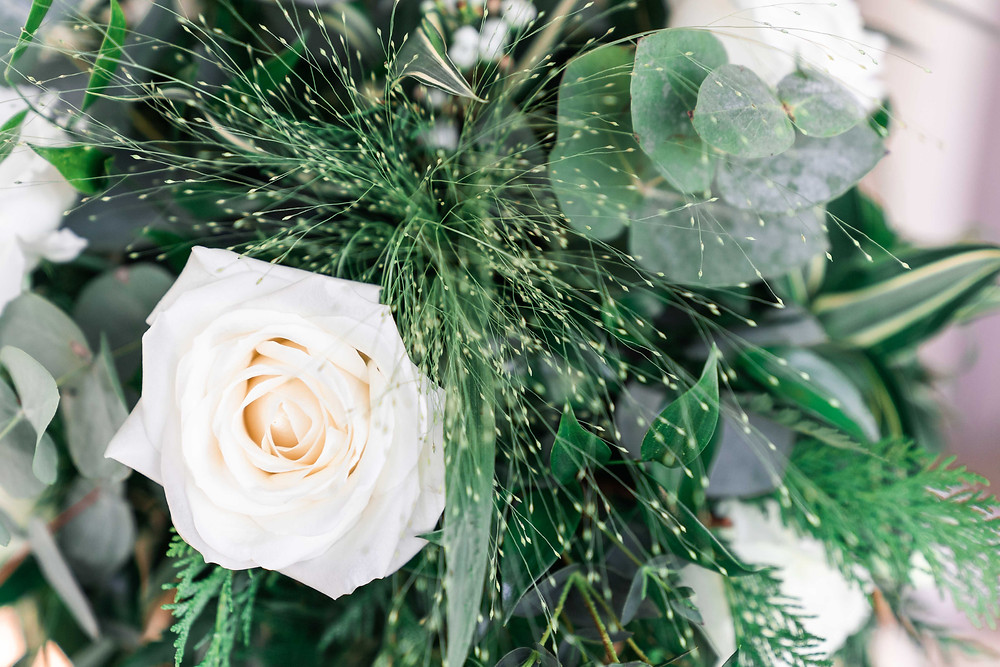 Derbyshire wedding florist with white rose in bouquet. Leicestershire wedding photography.