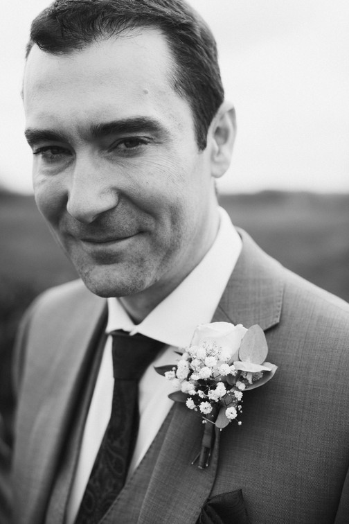 Black and white wedding photography. Groom portrait ready to tie the knot.
