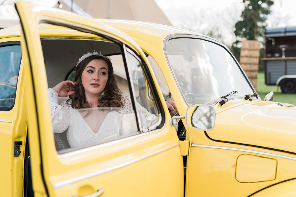 Wedding VW Beetle wedding car with bride and tipi wedding venue backdrop
