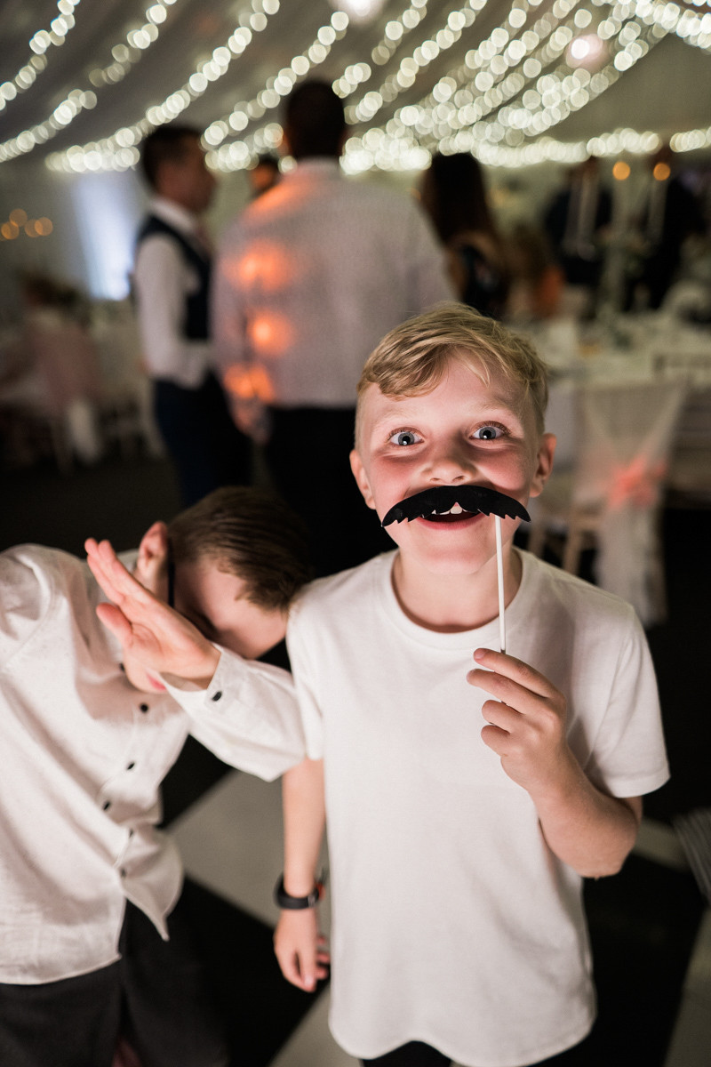Wedding reception photography in Leicestershire. Dance floor props and dabbing for the kids.