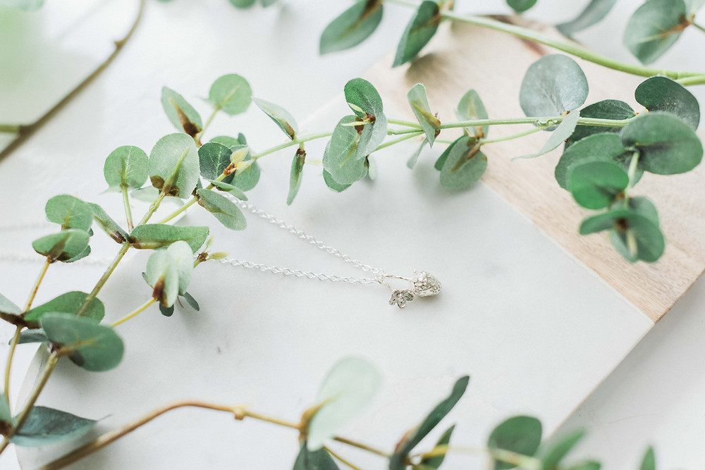 This sterling silver strawberry pendant by Lucy Flint Jewellery could be the perfect bridesmaids jewellery. Image by Darley and Underwood Photography. Wedding photography in the Midlands.