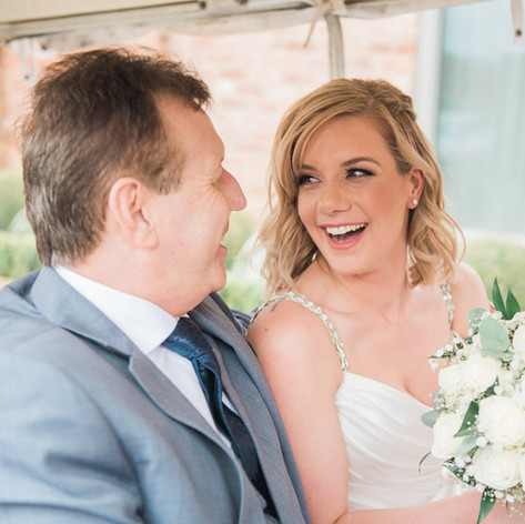 Natural, documentary wedding photography in Nottingham. Bride arrives with her father.