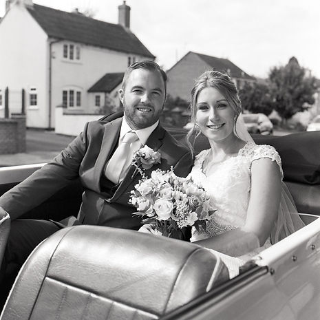 Bride and Groom in car, shot on film (Ilford HP5). Wedding Photography, Leicestershire, Nottinghamshire, Warwickshire, Rutland, Derbyshire.