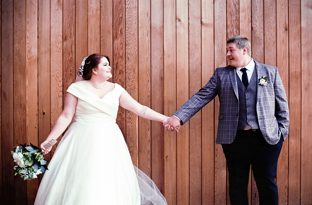 Bride and Groom Holding Hands. Darley and Underwood Photography, Midlands Wedding Photographers. Wedding Photography on Film.