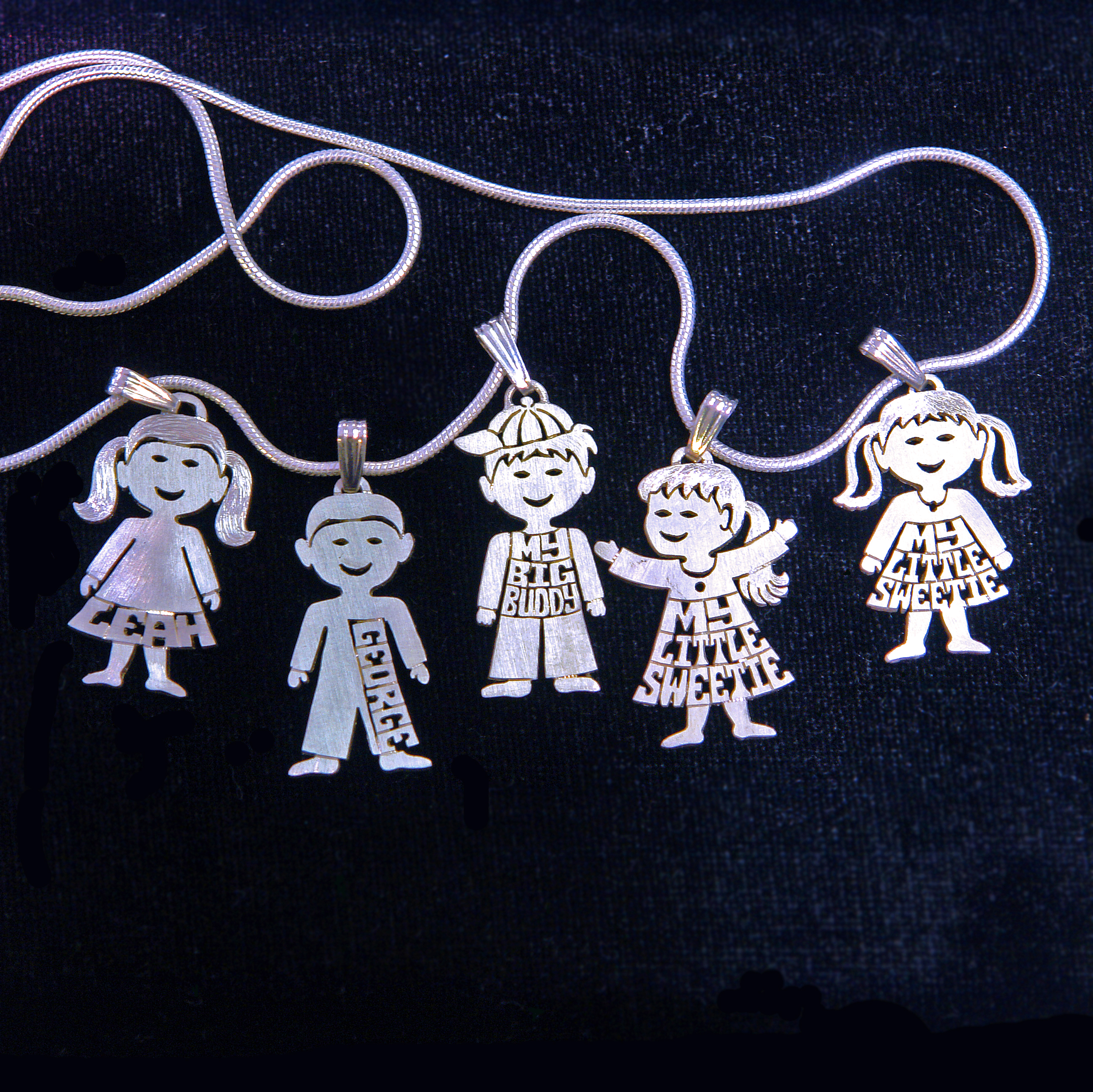 Silver kid pendants