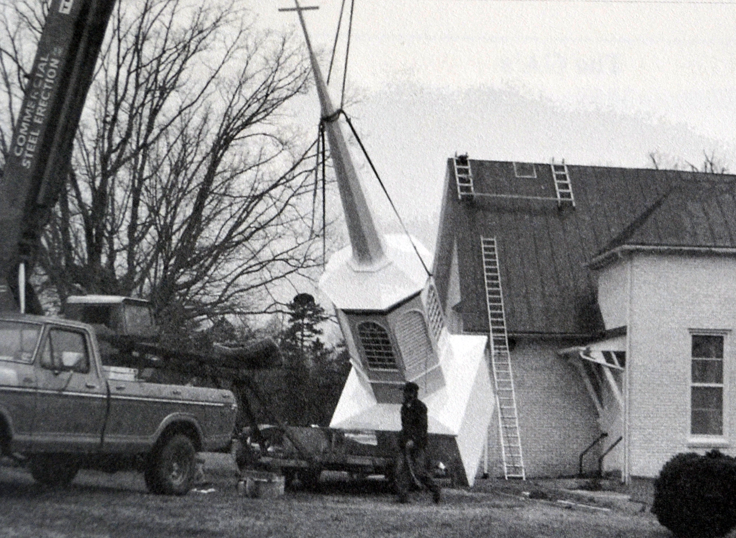 Steple being erected Febuary 1986