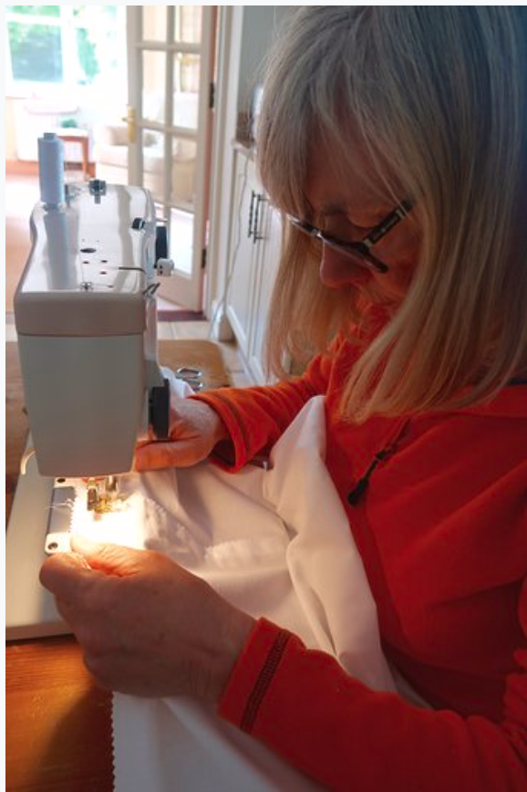 Linda making an isolation gown.