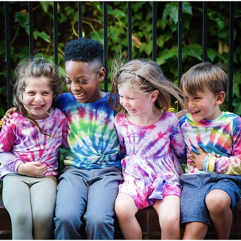 children with tie dyed shirts.jpeg