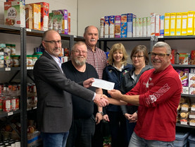 GPMC & NMC Donate $25,000 to the Food Bank