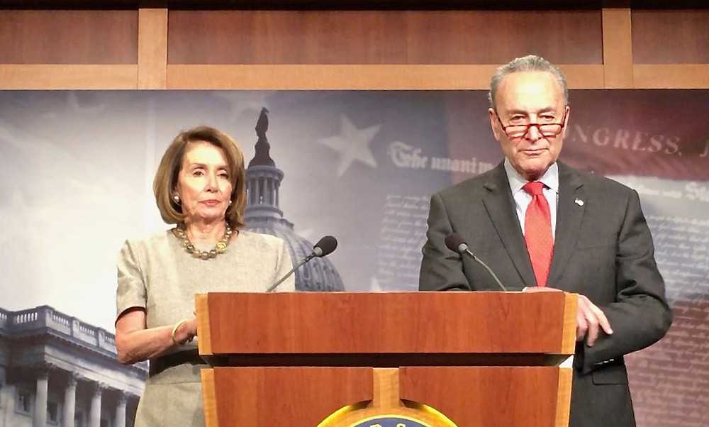 Nancy Pelosi and Chuck Schumer speak to reporters after President Trump agreed to end the government shutdown for three weeks.