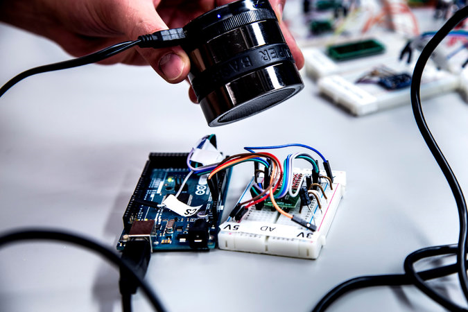 A speaker can make tones that fool a sensor and cause a microprocessor to accept the sensor readings. Credit Joseph Xu/University of Michigan