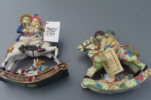 216. A Pair of Rocking Horse Ornaments