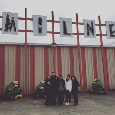 Family in front of Milne Implement