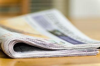 Visuel représentant un journal afin de présenter la page où la presse parle de la galerie Artopic