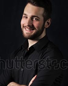 young-man-beard-black-shirt-600w-7518741