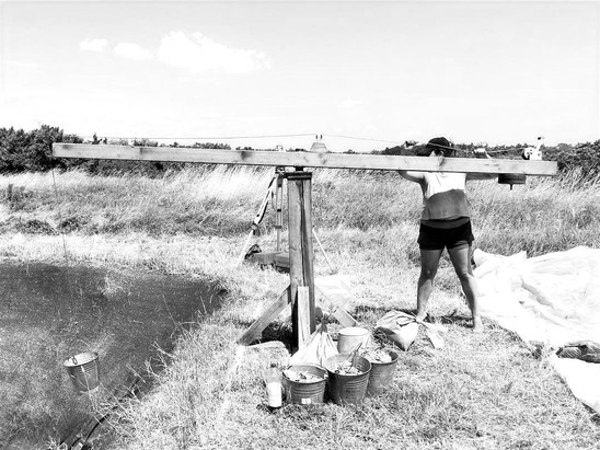 Working the winch at Százholambatta archaeological site.