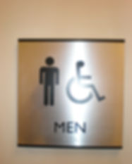 Metal_male_restroom_sign_with_braille.jp
