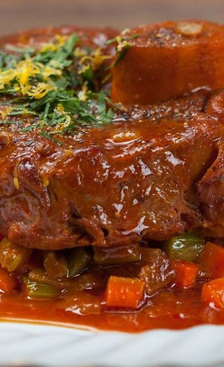 Veal Osso Bucco Served With Creamy Polenta & Mesclun Salad