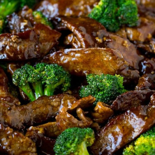 Beef & Broccoli Served With Vegetable Rice Noodles & Spring Rolls