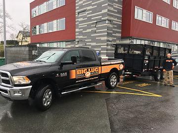 Big Lug branded junk removal tow vehicle