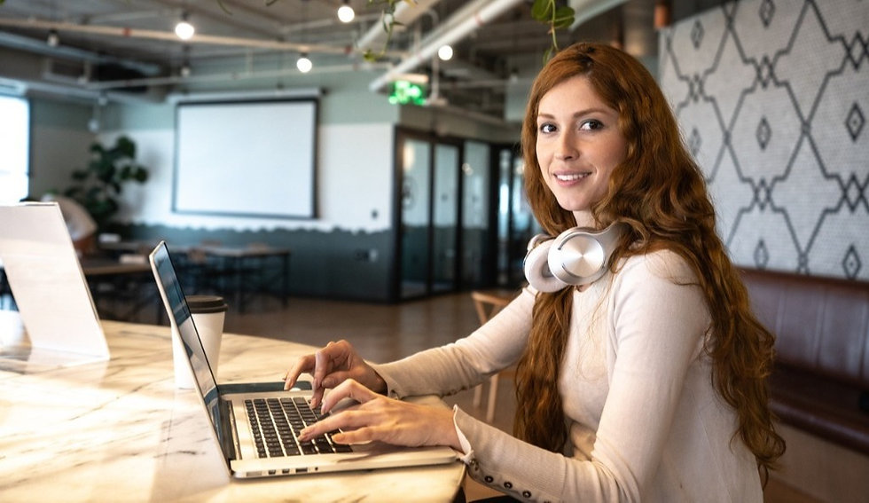 portrait-of-young-businesswoman-working-with-laptop-at-coworking-picture-id1210345688_edited_edited.