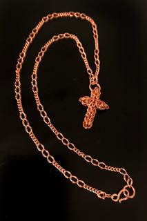 Gene Carter, Cross Necklace