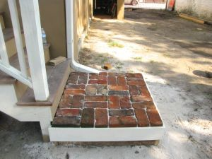 Back landing with salvaged bricks
