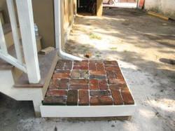 Back landing with salvaged bricks
