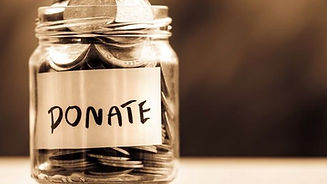 glass-jar-full-of-cois-with-donate-writt