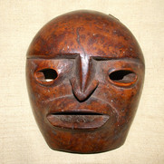 A North West Coast cedar burl mask.
