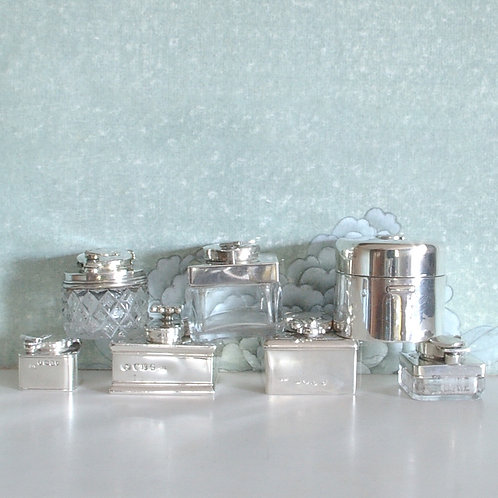 A collection of 19th C. silver travelling inkwells.