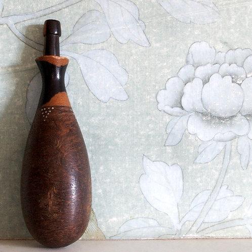A Kamba snuff bottle.