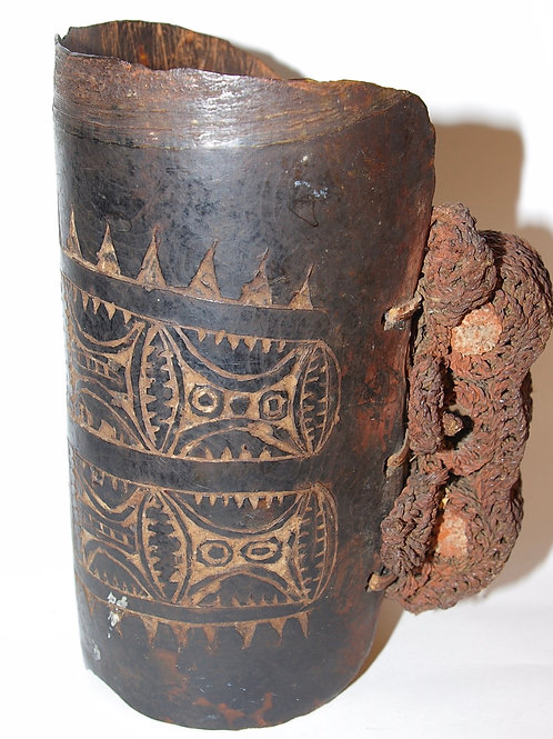 A Latmul turtle shell and wickerwork armband. Central Sepik, Papua New Guinea.