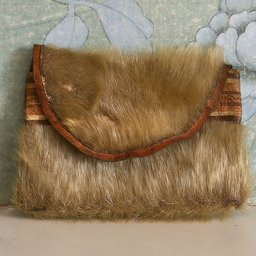 An Inuit seal skin pouch.