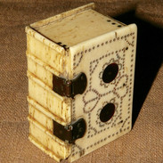 An 18th C bine box in the form of a book.